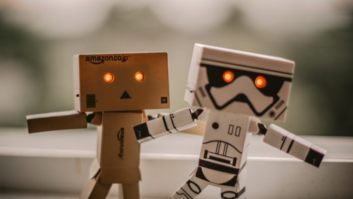 Cardboard androids walking with glowing eyes